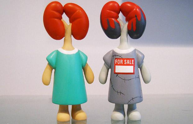 The standard kidney donor doll, and the limited edition Black Market Kidney doll Picture: WENN