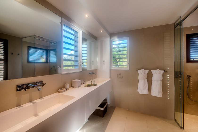 bathroom at villa turtle nest with two sinks