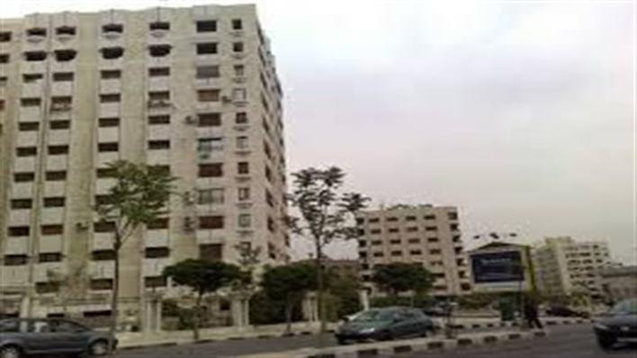 الصحي السوري - النظام السوري ..يحجر بناء قريباً من سكن الأسد بعد إصابة بفيروس كورونا