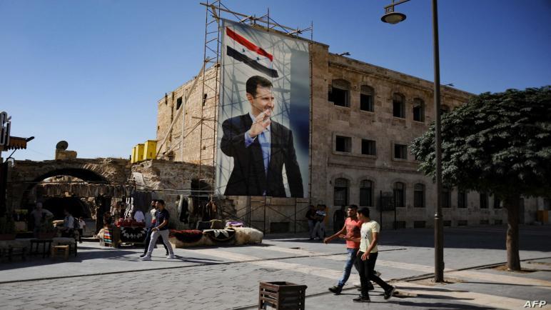 000 9896ZF scaled 6zwj4g53dhb7b1ibiw12tgtjf8jt05hl7pxixd4l80j - بالفيديو.. شاب سوري بإزالـ.ـة صور بشار الأسد وسـ.ـط شـ.ـوارع سيـ.ـطرة النظام (فيديو)