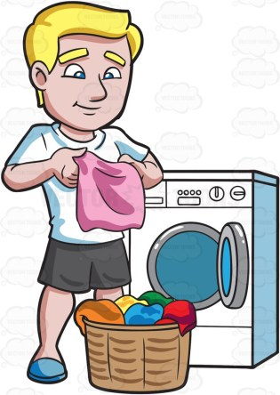 A man with blonde hair, wearing a white shirt, black shorts and blue pants, smirks as he folds a pink cloth, that is freshly washed by the white washing machine behind him, to place with the pile of clothes in a brown laundry basket