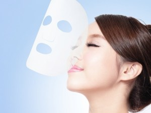 Relax Young woman with cloth facial mask