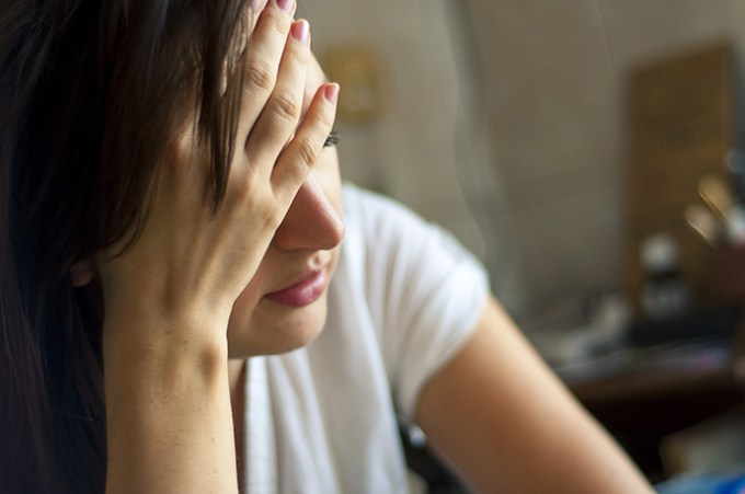 An image of girl with headache