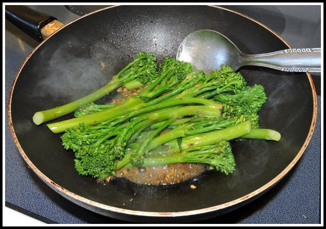 Adding XO Sauce to Broccolini while Stir-frying