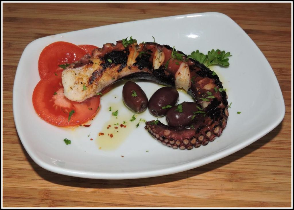A grilled octopus tentacle served as Meze style Greek appetizer