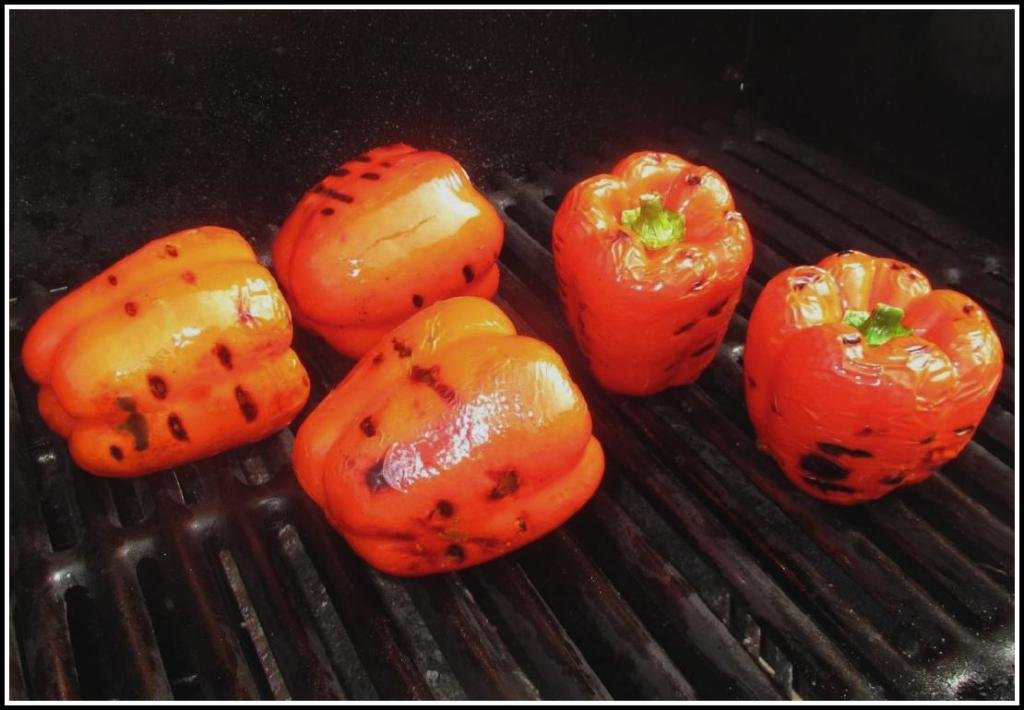 A batch of peppers on the grill