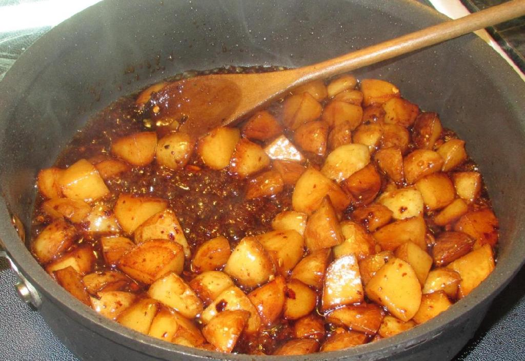 Braising the potatoes and forming a glaze