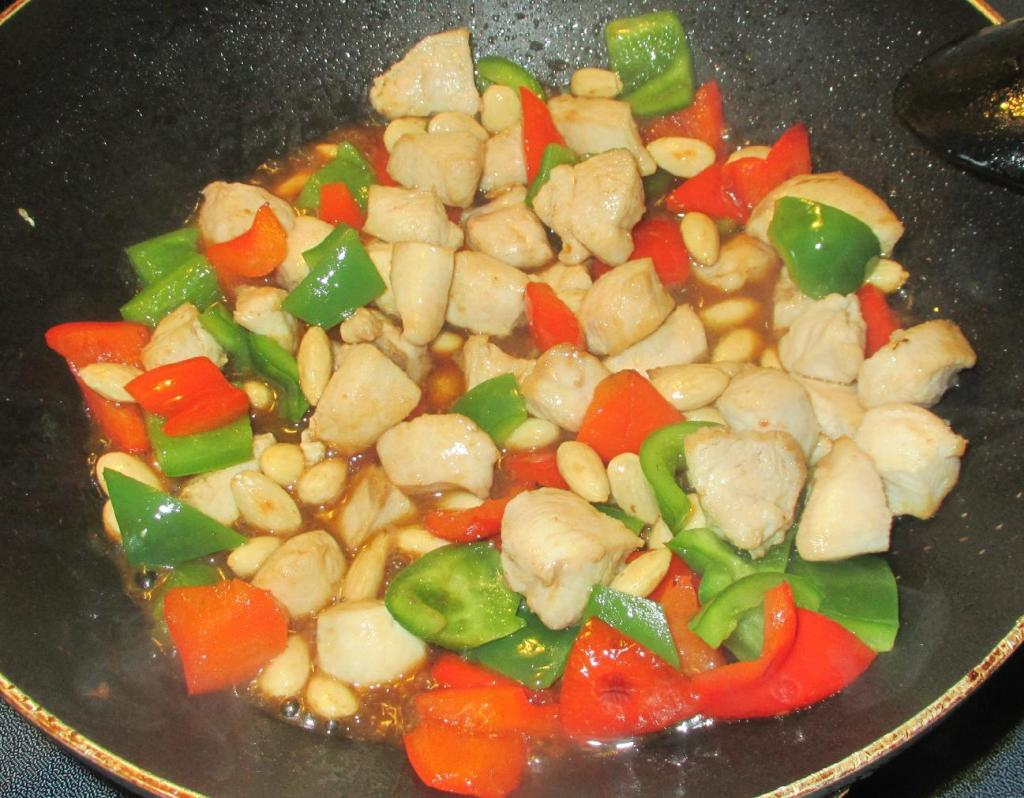 Finishing Chicken with Almonds and Peppers
