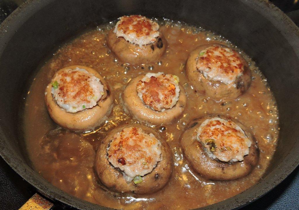 Cooking Stuffed Mushrooms in Sauce