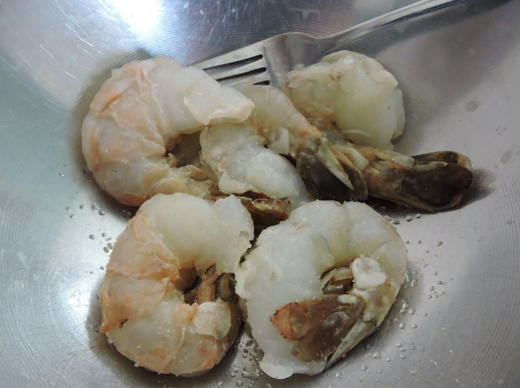 Shrimp being Seasoned