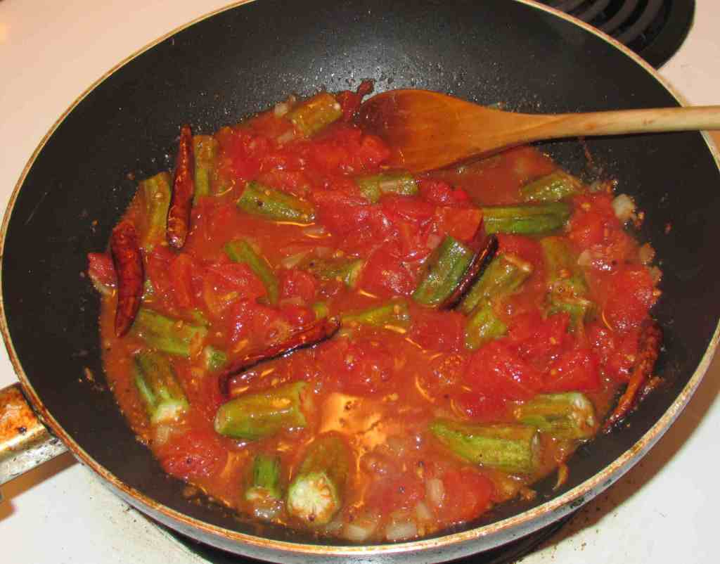 Finishing an Okra and Tomato Curry