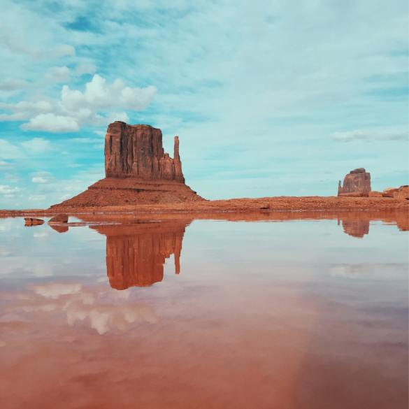 American landscape with red rock and its reflection