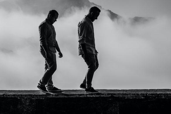 Two men walking on ridge