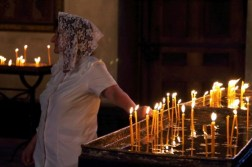 Worshipper lights candles at Echmiadzin