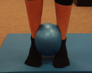 Exercise for ankle using pilates ball