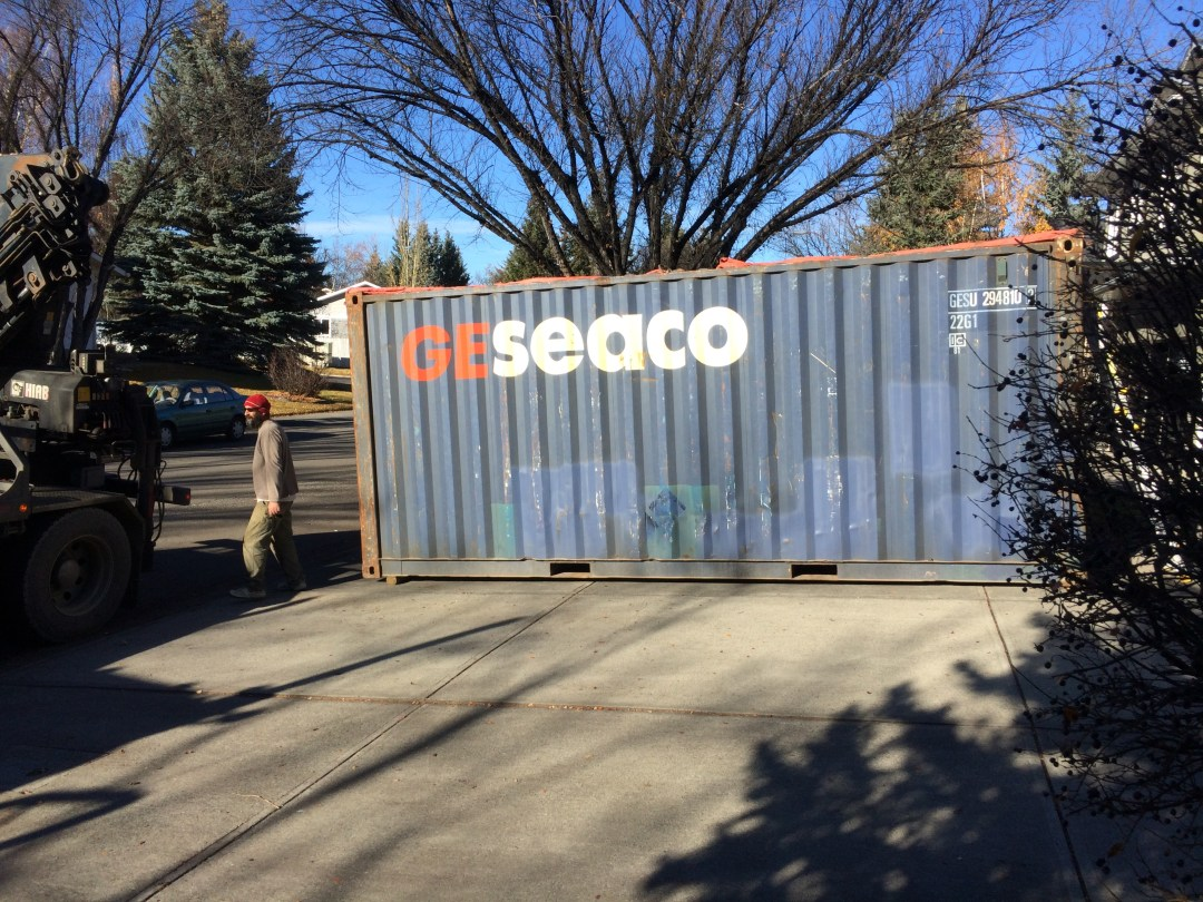 Our shipping container in the driveway ready to be taken to storage.