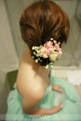 Natural loose bun with fresh flower