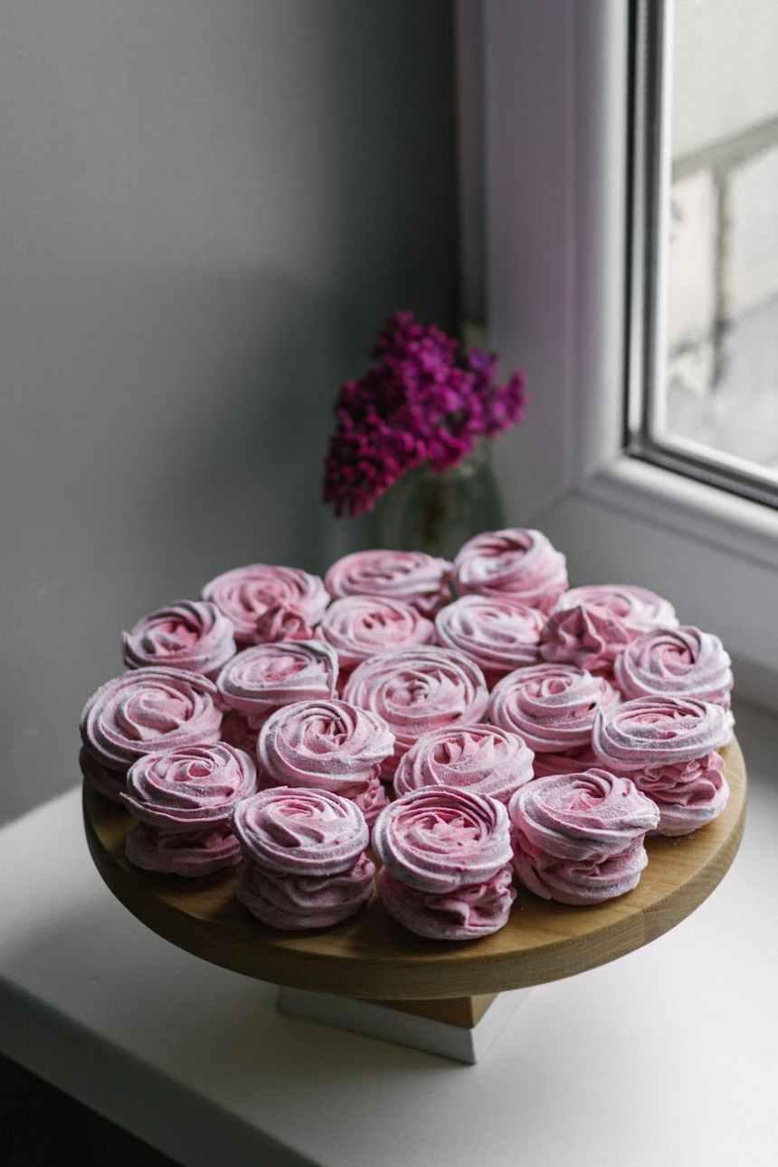 sweet zephyr for dessert near flowers in glass vase
