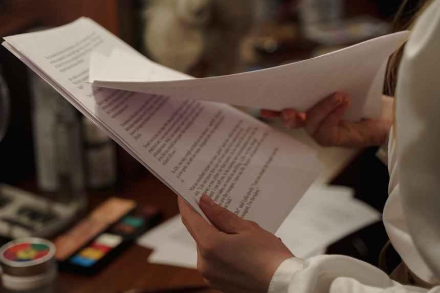 person reading a script