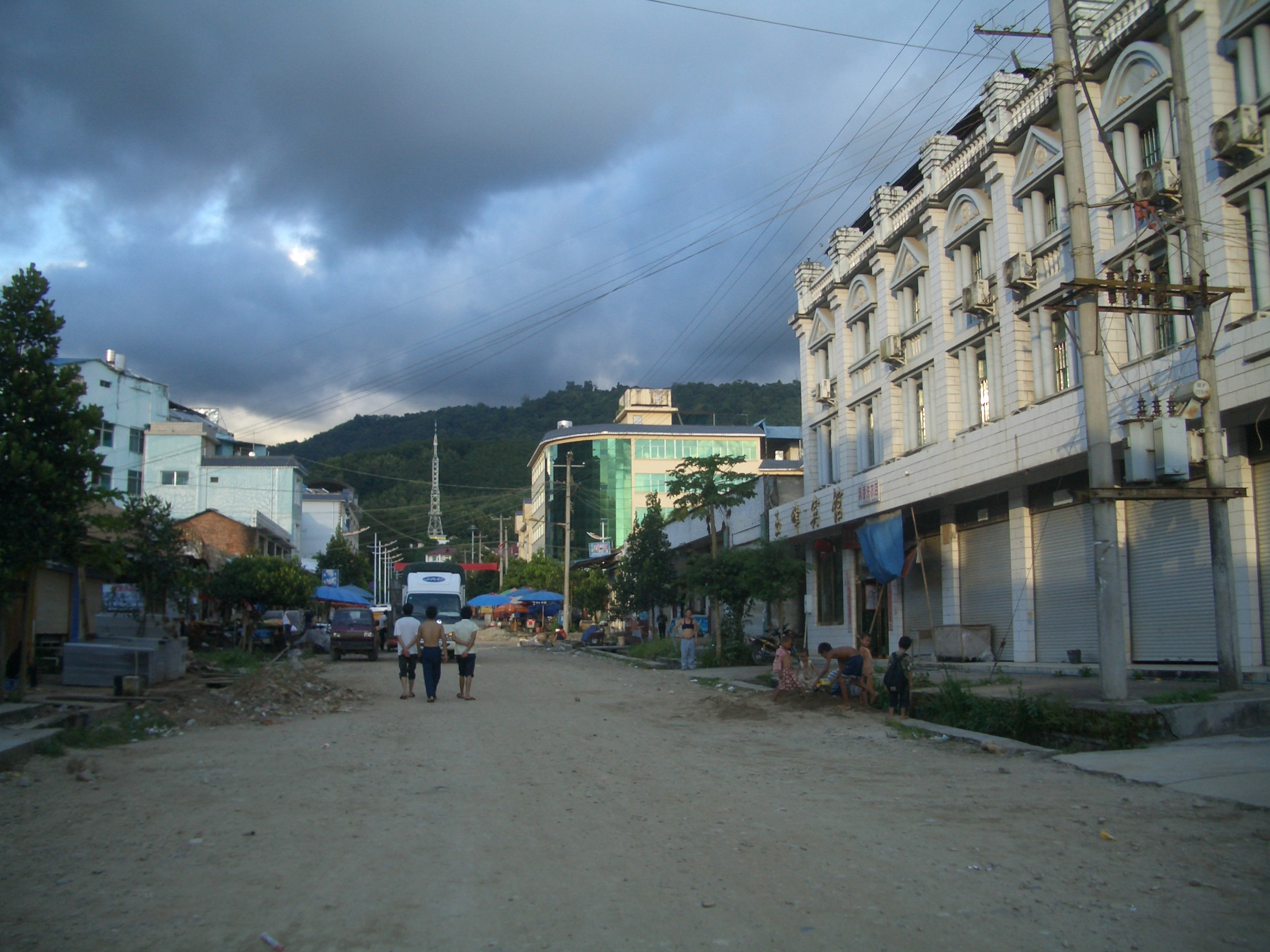 The brothel is in the building to the right. This is a Chinese neighborhood of a S.E. Asian country.