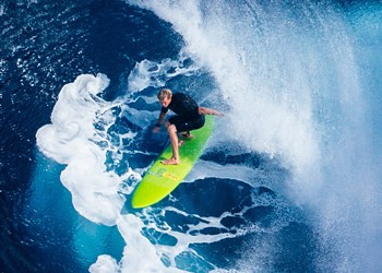 surfer riding waves / long-term growth