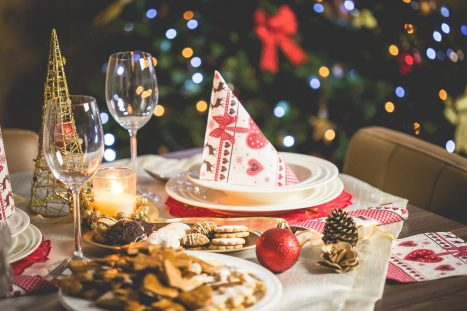 blur  bokeh  candle  christmas  christmas decoration  christmas tree  close-up  decoration  dining  dinner  focus  food  glass  holiday  lights  pine cone  plate  plates  sweets  table  table setting  wine glass
