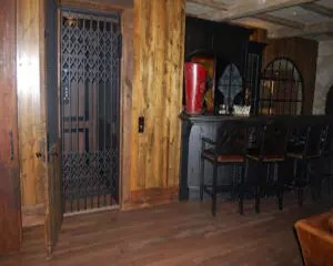 Hydraulic home elevator, providing access to lower level entertaining area