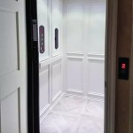 Symmetry Custom Home Elevator Car with Raised Panels