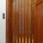 Home elevator wrap around gate with vision panels