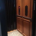 Symmetry Home Elevator Raised panel Cherry Clear Coat