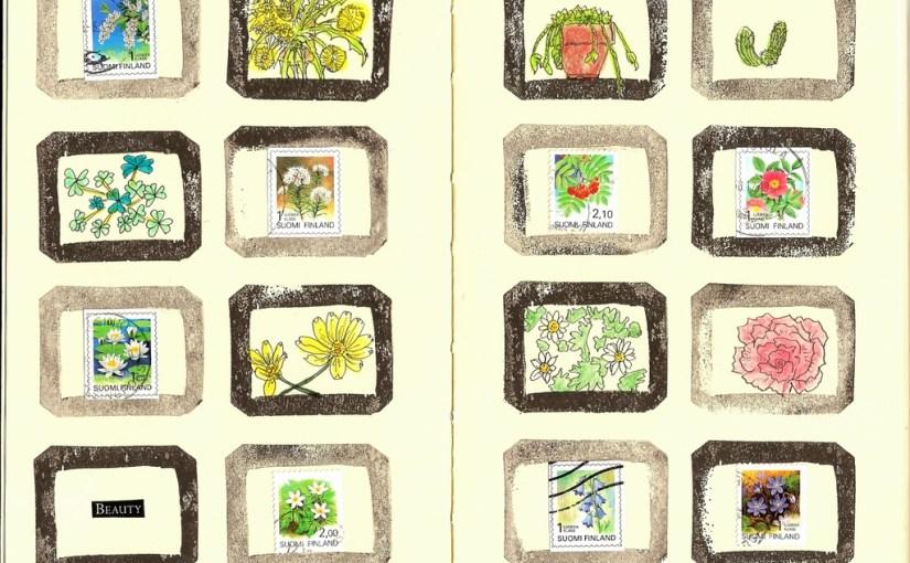 フィンランドの花の切手をモレスキンに配置、消しゴムはんこのフレームで