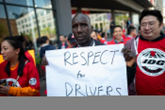 Members of the Independent Drivers Guild take part on the solidarity rally in support of drivers at the the Uber and Lyft New York City Headquaters on May 8, 2019 in New York City.