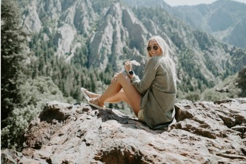 happy woman sitting on cliff, no such thing as failure