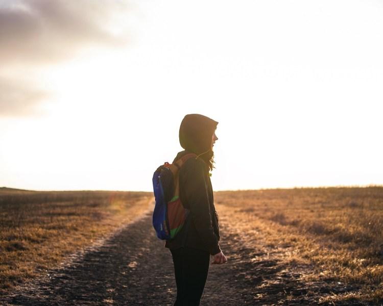 person on walk alone