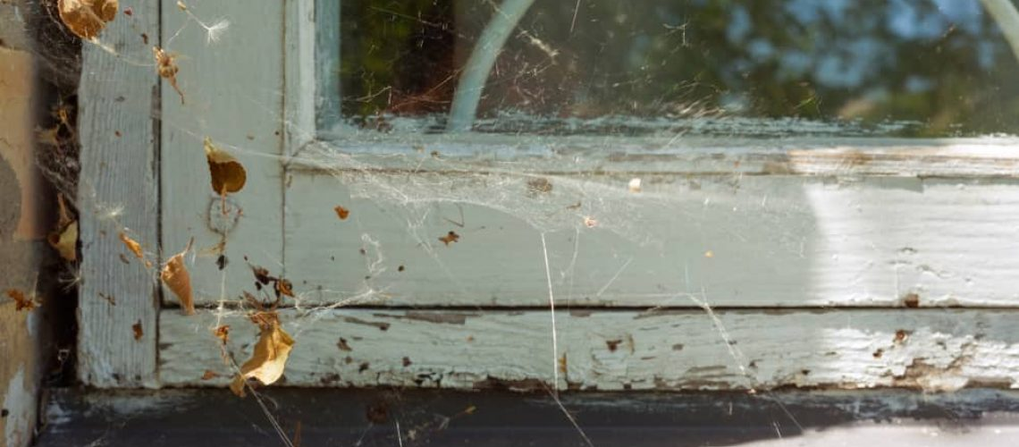 Window,Detail,In,The,House,With,A,White,Wooden,Cracked