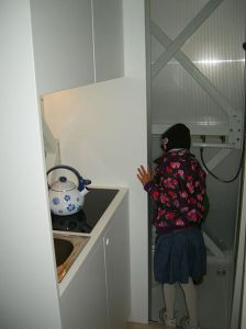 In the kitchen looking into the toilet               www.shabbat_goy.com with CCLicense
