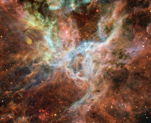 Tarantula Nebula, 170,000 light years from Earth and part of the Large Magellanic Cloud. Credit: ESA/NASA, ESO and Danny LaCrue