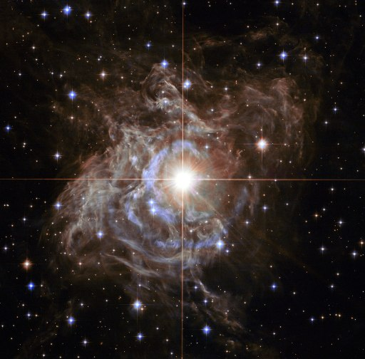 The bright star RS Puppis, a Cepheid variable star in the constellation Puppis, roughly 6,500 light years away and surrounded by dust. Credit: NASA, ESA, and the Hubble Heritage Team (STScI/AURA)-Hubble/Europe Collaboration Acknowledgment: H. Bond (STScI and Penn State University)