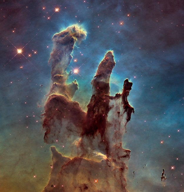 The Pillars of Creation, interstellar dust in the Eagle Nebula. The large formations are called elephant's trunks. News stars are being formed here, even as radiation and solar winds erode the dust clouds. Credit: NASA, ESA/Hubbleand the Hubble Heritage Team