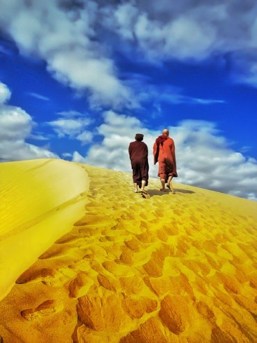 Monk In Desert Walking In Dessert Theravada Buddhism