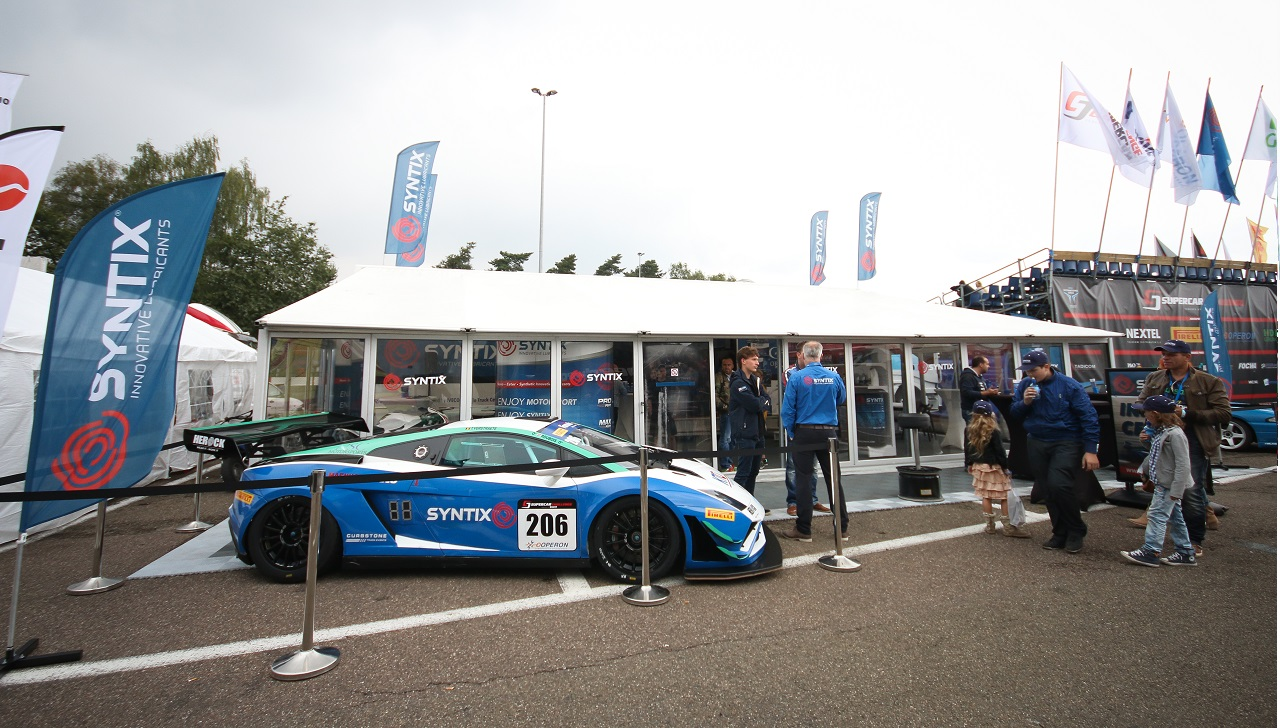 Syntix Superprix in Zolder - Supercar Challenge powered by Pirelli - White and blue Lamborghini Gallardo FL2 GT3 stand - Syntix Innovative Lubricants