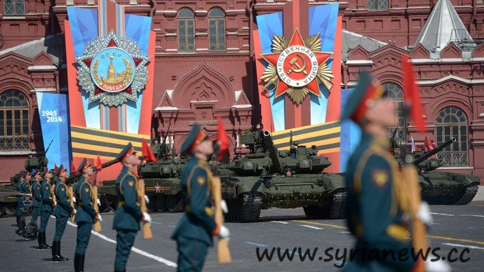 Russian servicemen march during the Victory Day parade in Moscow's Red Square May 9, 2014.