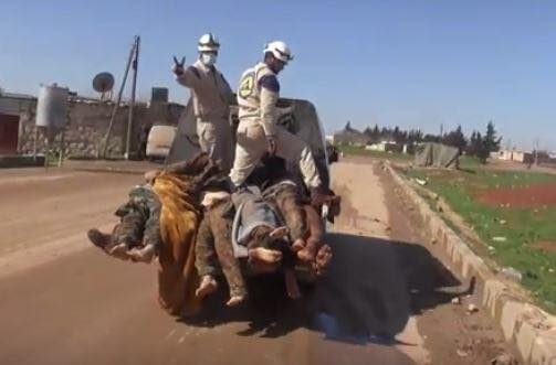 """Humanitarian White Helmets stand on Syrian corpses while making the """"victory"""" sign"""