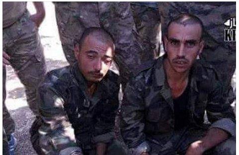 SAA soldiers before beheading.jpg