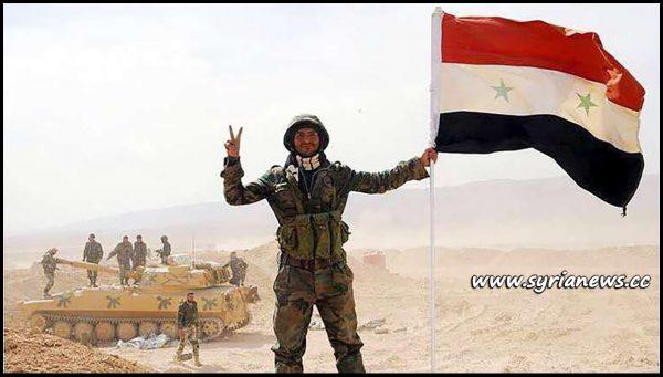 image-Syrian Arab Army Soldier Raising Syrian Flag deir ezzor