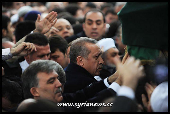 image-Turkish president Gul and Turkish PM Erdogan at Erbakan's Funeral