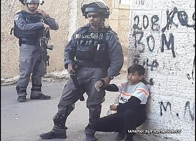 Israeli IDF terrorists kidnap a Palestinian child of 11 years old in Isawiya near Jerusalem