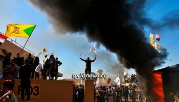 Iraqis march on the US Embassy in Baghdad protesting the massacre of 30 members of Iranian-allied militia fighting ISIS