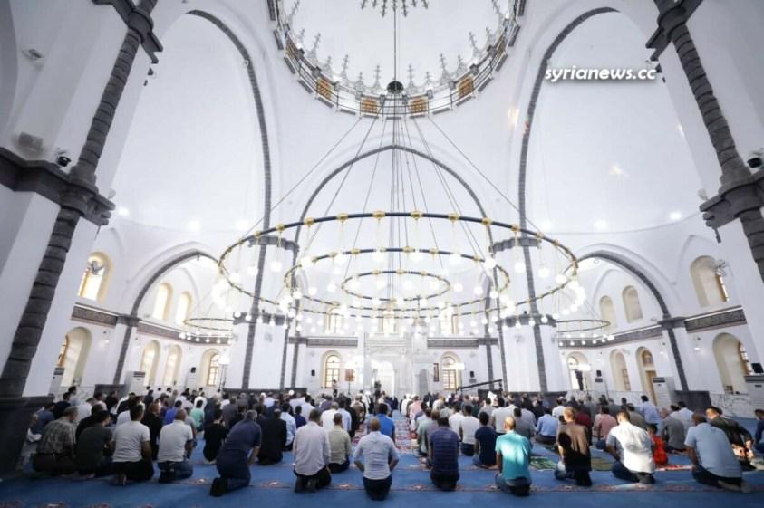 President Bashar Assad performs Eid Adha prayers in Khalid Ibn Al Waleed Mosque in Homs