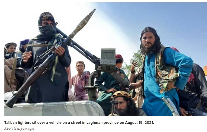 Chilling foto of Taliban armed with RPGs, driving thru the city.